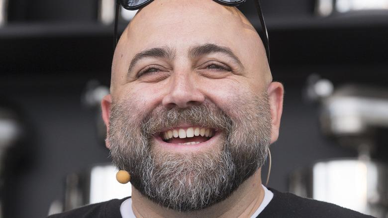 Duff Goldman smiling with sunglasses on head