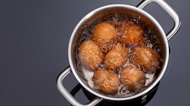 eggs boiling in pot