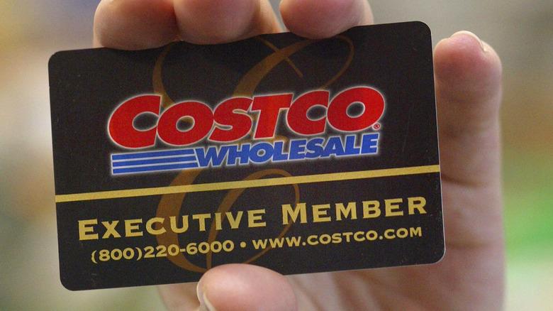 Hand holding a Costco membership card