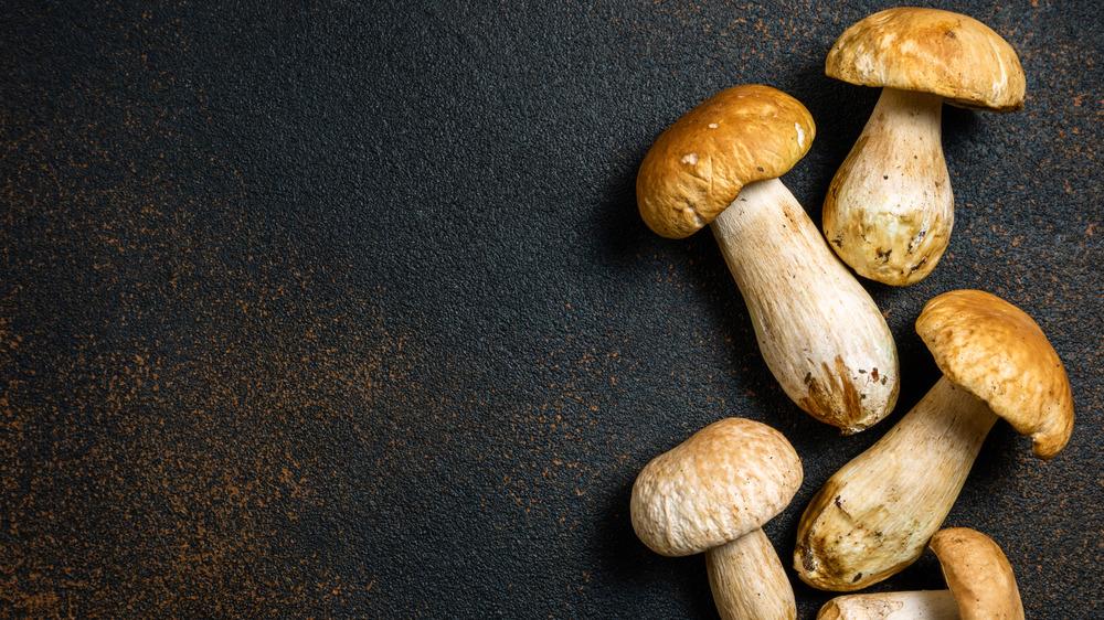 whole mushrooms on a dark table