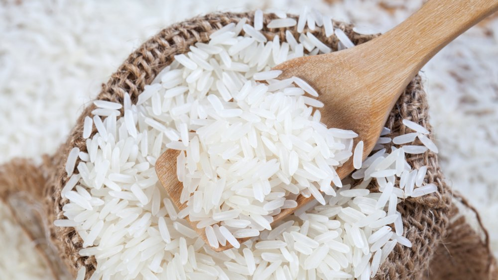 bag of rice with wooden spoon