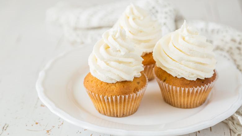 Vanilla cupcakes on white plate