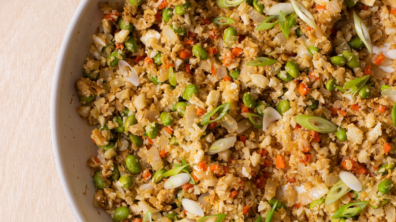 Vegetable fried cauliflower rice in a skillet