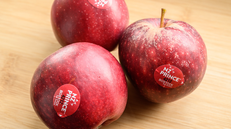 Red apples with PLU stickers