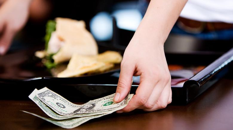 server receives cash tip