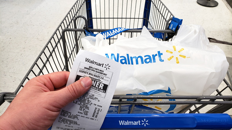 Walmart customer with receipt and cart