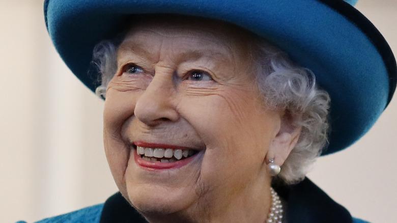 Queen Elizabeth, blue hat