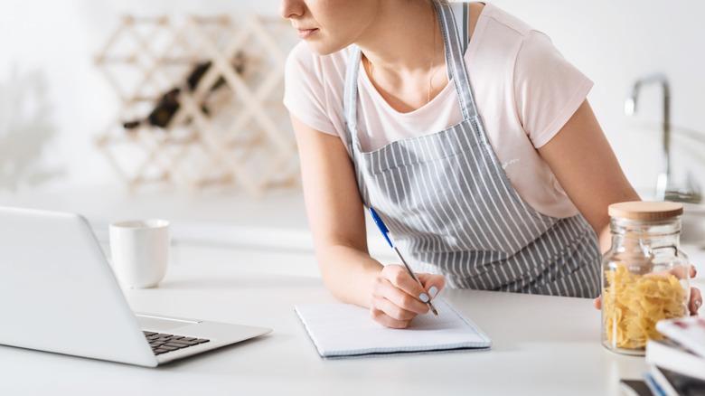 Recipe tester taking notes