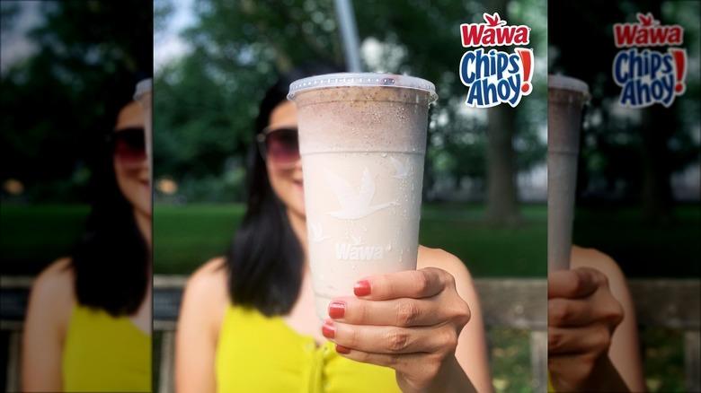 Woman holding Wawa Chips Ahoy milkshake