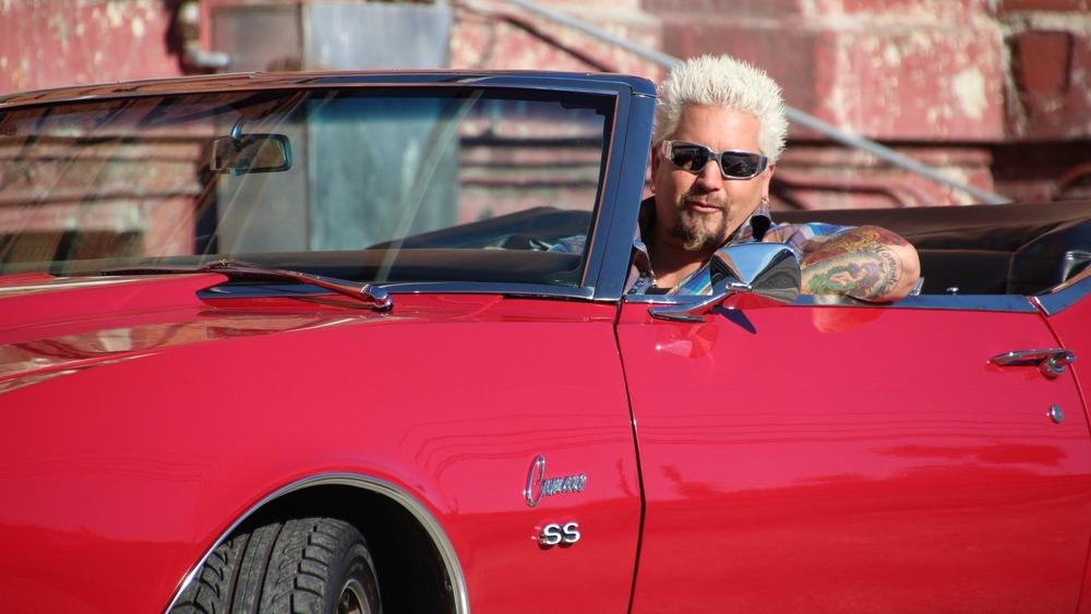 Guy Fieri drives red Camaro