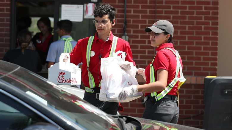 chick-fil-a workers at the drive-through