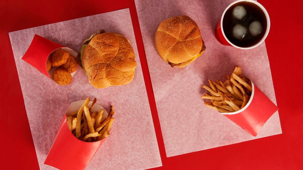 A spread of two Wendy's meals on a red background