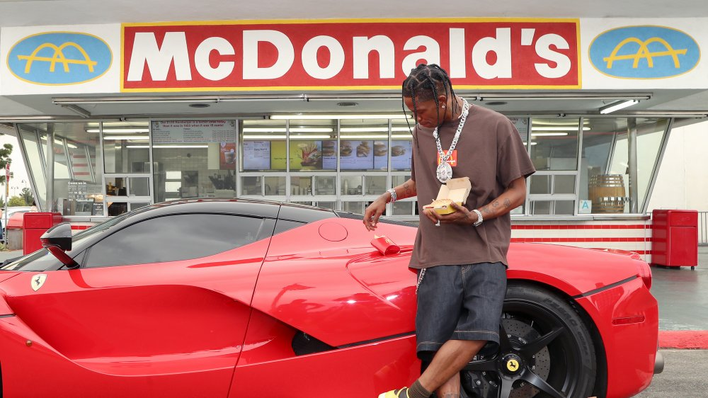 Travis Scott outside of McDonald's with Cactus Jack meal