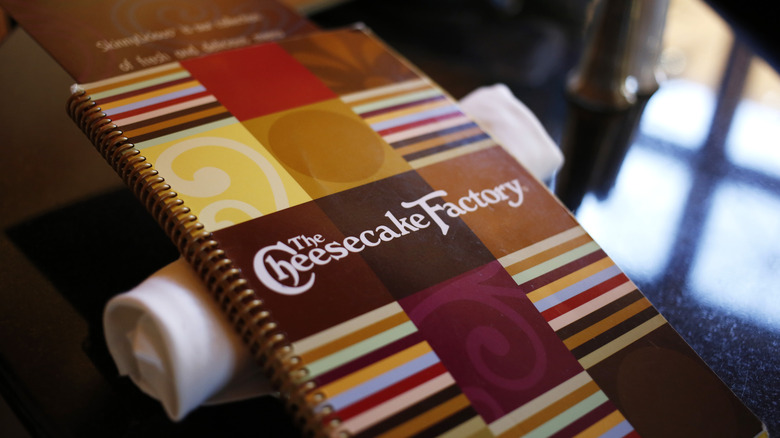 Cheesecake Factory menu on a table