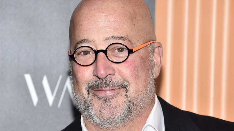 Andrew Zimmern in black and orange glasses
