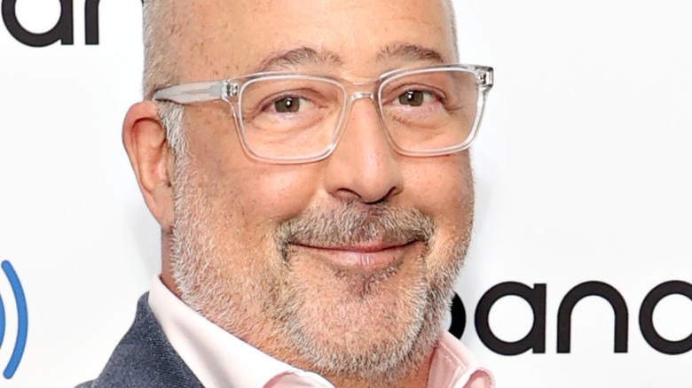 Andrew Zimmern with clear glasses