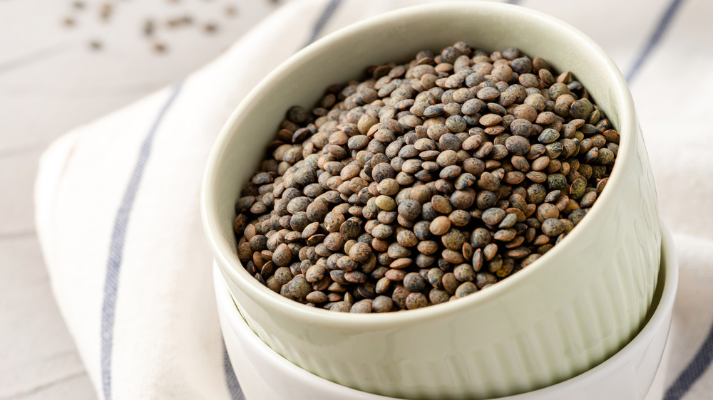 French lentils in a white serving bowl
