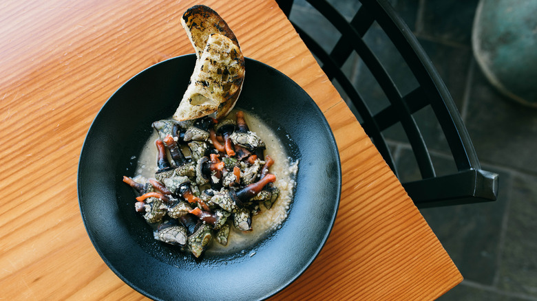 Gooseneck barnacles in a black dish