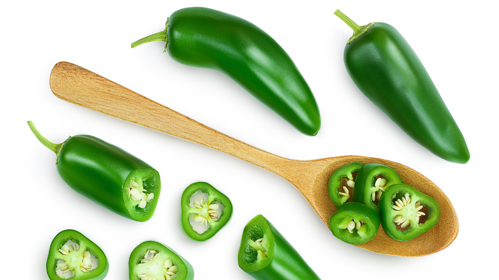 whole and cut jalapeño peppers
