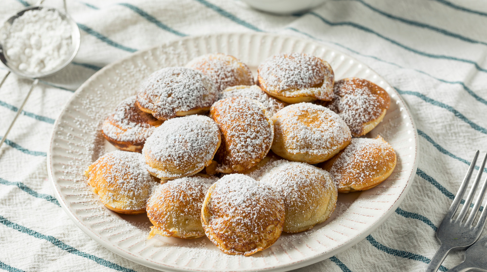 A white plate with poffertjes