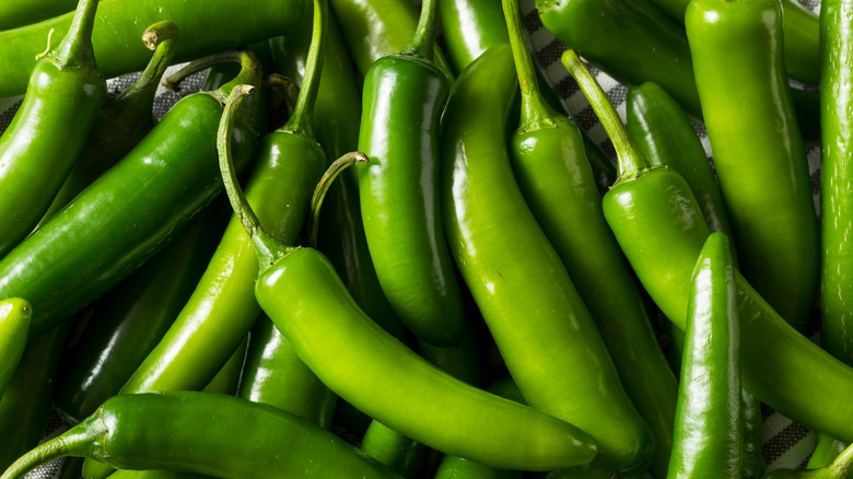 background with green Serrano peppers