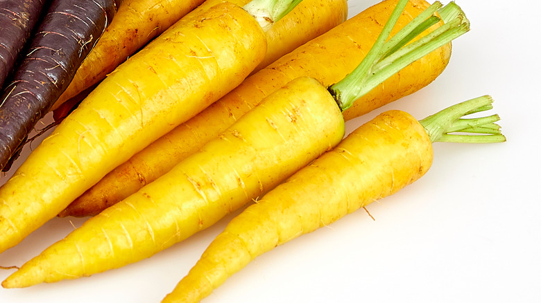 Yellow carrots on a white background