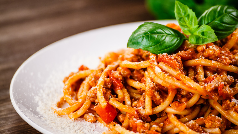 Tomato spaghetti with parmesan and basil