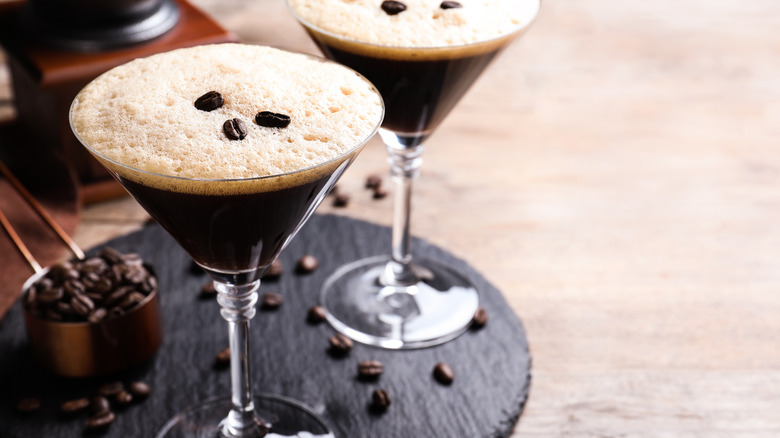 Espresso martinis on a brown tray