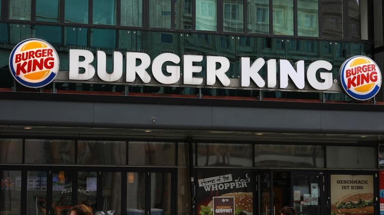 people passing Burger King