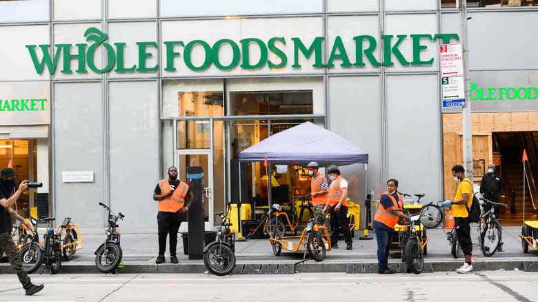 Whole Foods store with people outside
