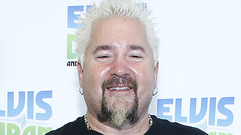 Guy Fieri smiles in close-up