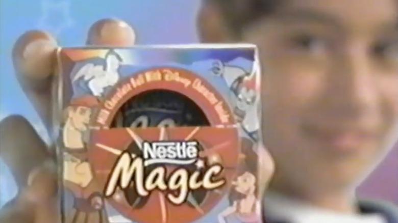 Kid holding Nestle Magic Ball