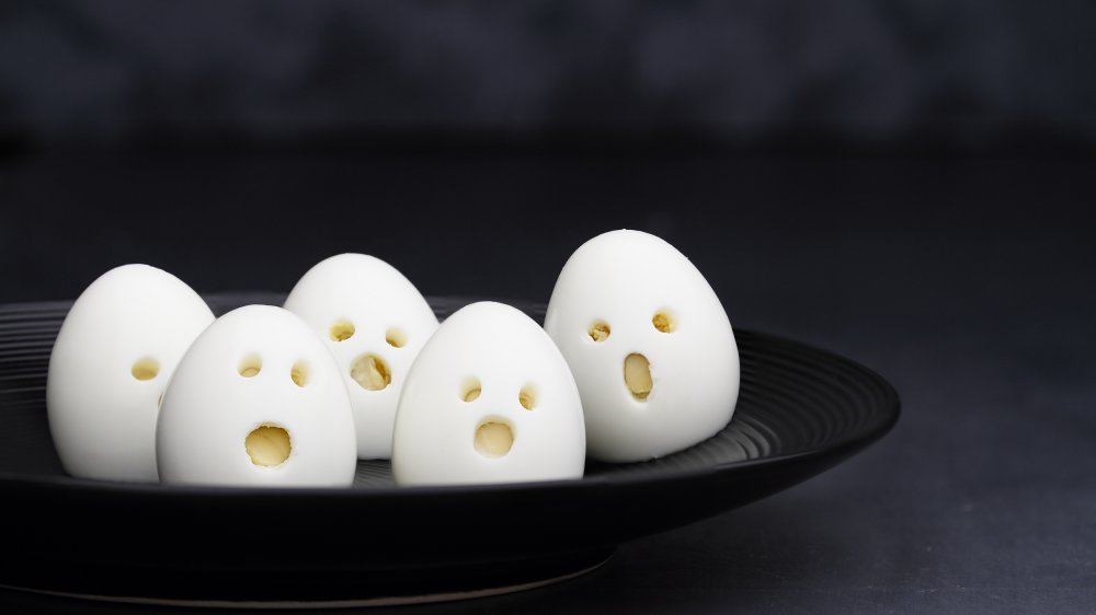 boiled eggs with carved faces