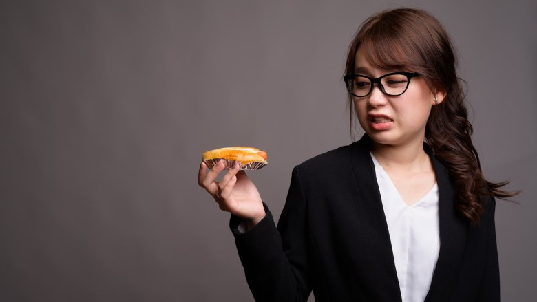 woman holding a hot dog