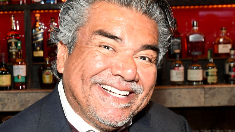 George Lopez smiling in bar