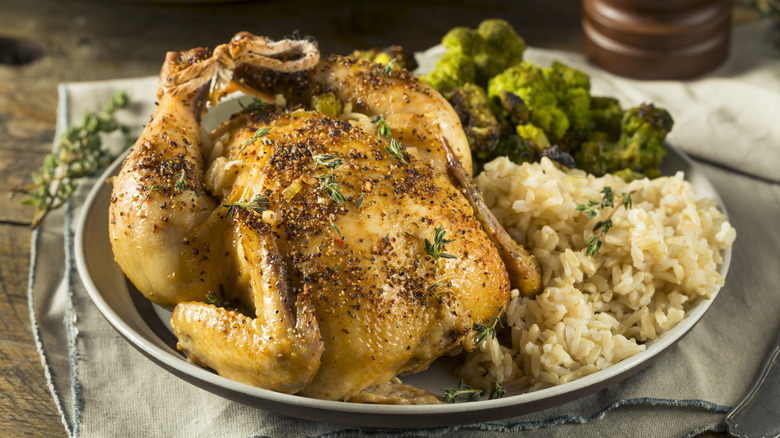 herby cornish game hens, rice, and vegetables