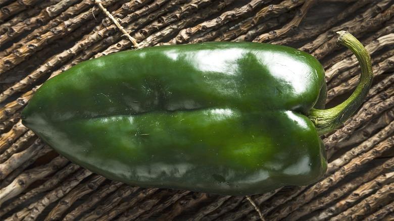 Dark green, long chili pepper
