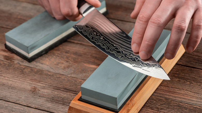 Sharpening a knife on a whetstone