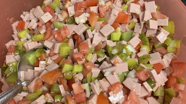 Bologna salad in a brown bowl