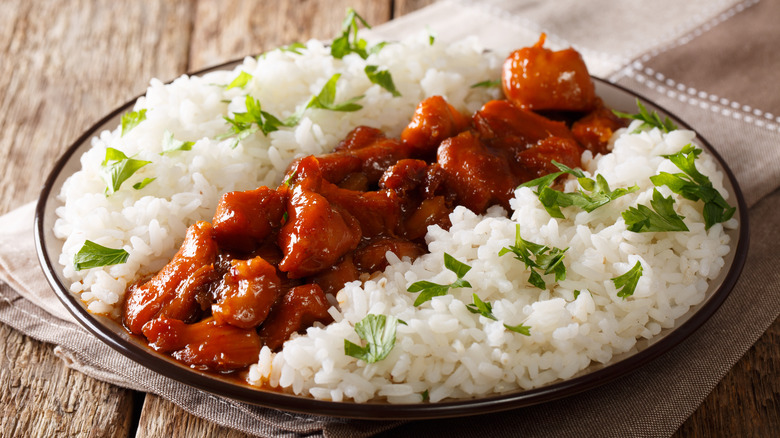 Bourbon chicken on a plate with rice