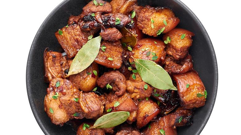 carne adobada pork in sauce with bay leaves