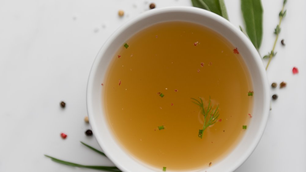 Clear soup with garnish