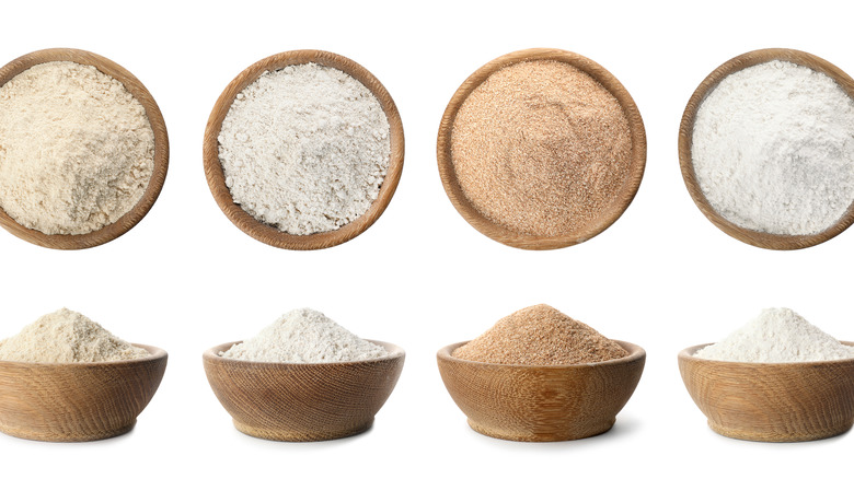 Various brown and white coconut flours in small bowls