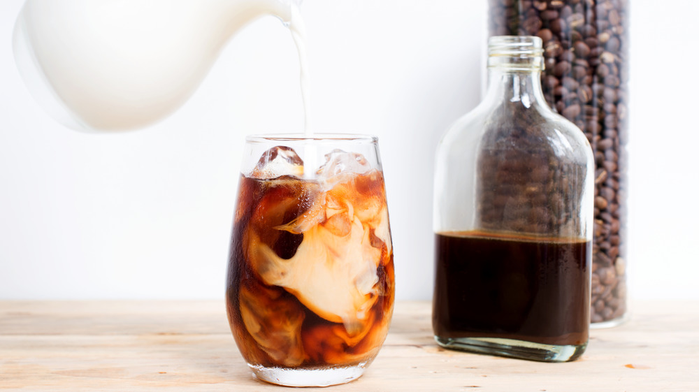 Cold brew with milk pouring in