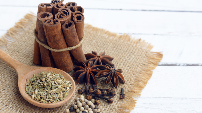 Ingredients for five-spice powder on burlap cloth