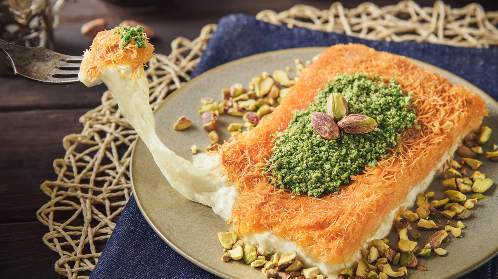 A fork stretching out the insides of a kunafa