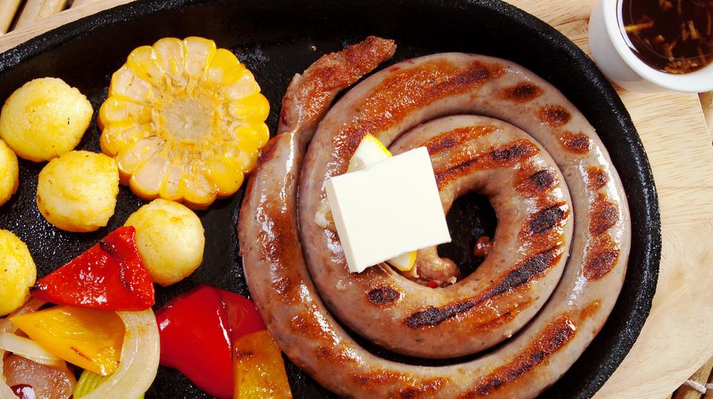 A mutura sausage and corn