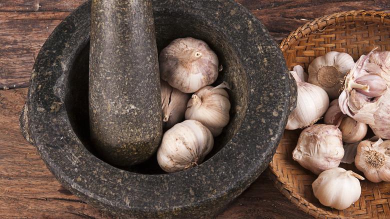 Garlic bulbs in a mortar and pestle