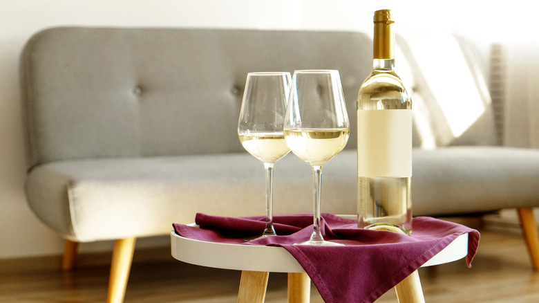 White wine with two glasses in living room