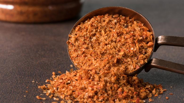 Tajin seasoning blend spilling from a spoon